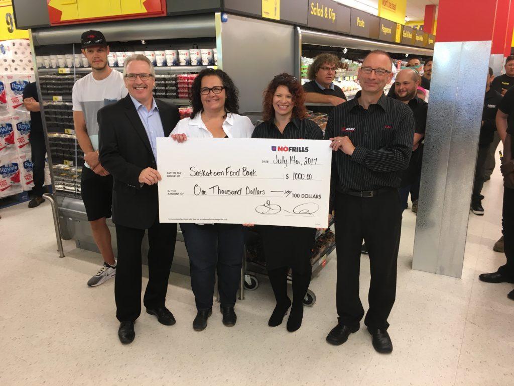 NO FRILLS GRAND OPENING-GORD & WENDY WIEBE DONATED$1000 TO SASKATOON FOODBANK