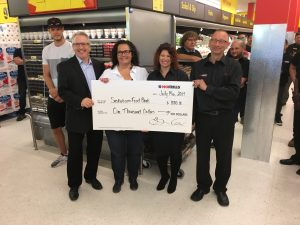 NO FRILLS GRAND OPENING-GORD & WENDY WIEBE DONATED$1000 TO SASKATOON FOODBANK