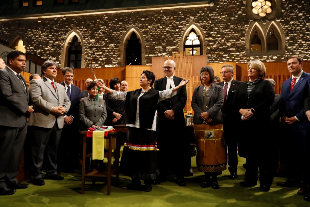 ELDER CLAUDETTE COMMANDA PERFORMING SMUDGING CEREMONY IN THE NEW HOUSE OF COMMONS WEST BLOCK